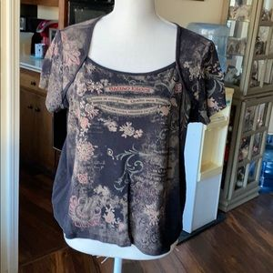 Cute black top with sparkle flower design.
